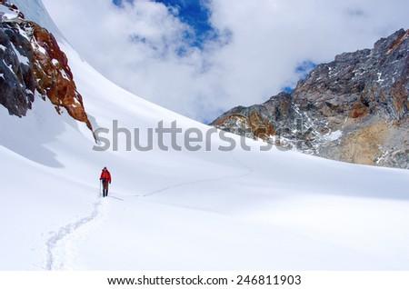 Hiker crosses Cho La pass in Khumbu valley. Sagarmatha National Park, Nepal, Himalayas - stock photo