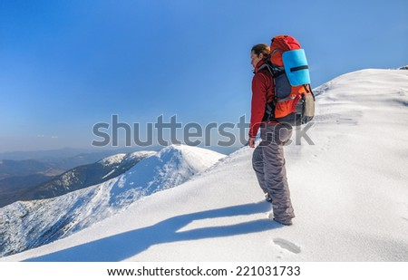 Hiker girl with backpack  in a high mountains - stock photo