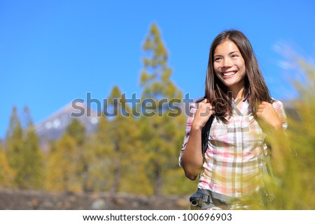 Hiker. Hiking woman portrait of happy female outdoors person during hike in forest on volcano Teide, Tenerife, Canary Islands, Spain, Young mixed race Asian Chinese / Caucasian girl. - stock photo