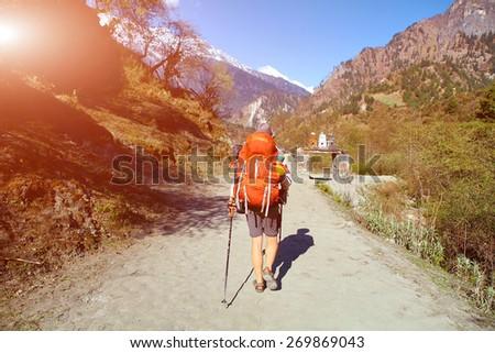 hiker in the Hamalayas mountains. Trek around Annapurna mount.  - stock photo