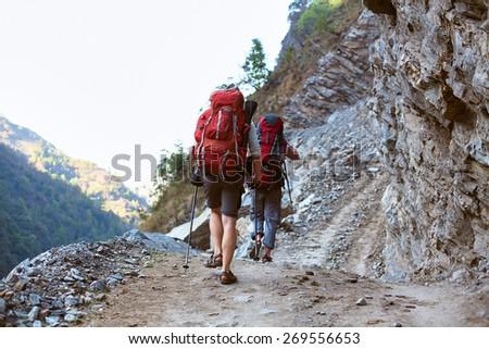 hiker in the Hamalayas mountains. Trek around Annapurna mount. Focus on the man. - stock photo