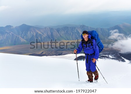 hiker in the mountain. Climb to the top. summer hiking - stock photo