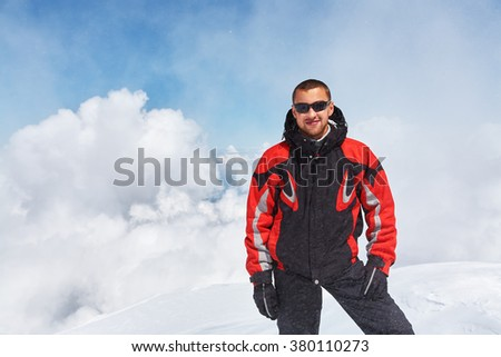 hiker in the mountain. mountain climber on top. mountaineering - stock photo