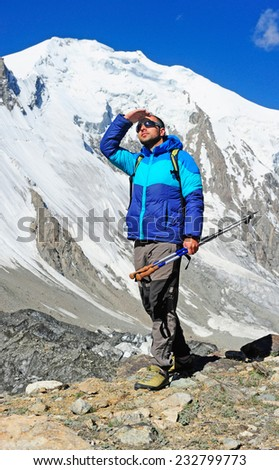 hiker in the mountains - stock photo