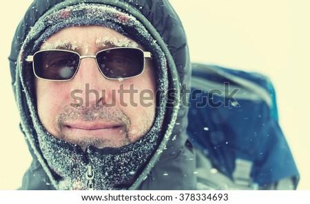 Hiker in winter season - stock photo