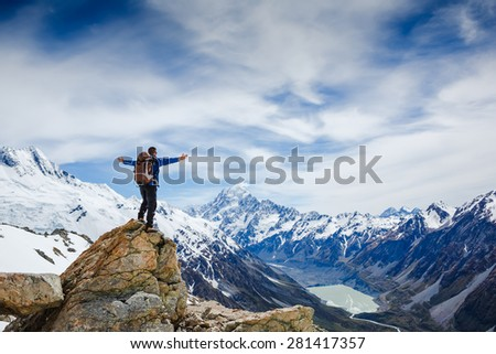 Hiker on the mountain top. Sport and active life concept - stock photo