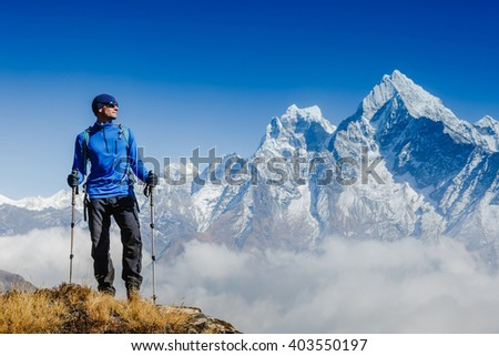 Hiker on the top in Himalayas mountains. Travel sport lifestyle concept - stock photo