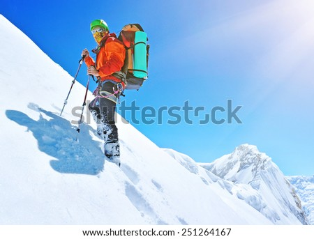 Hiker on the trek in Himalayas - stock photo