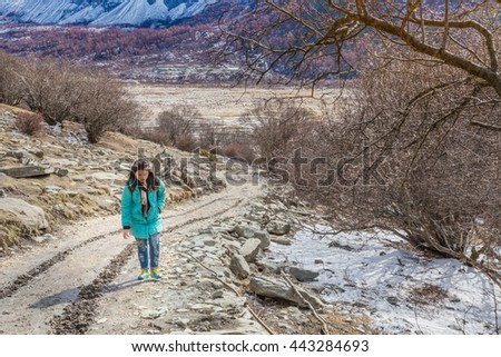 Hiker portrait. Female hiking woman happy  during hike trek on mountain in china .Beautiful young  Asian Chinese - stock photo