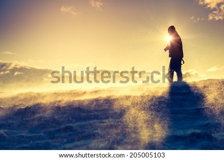 Hiker standing on top of a mountain. Dramatic scenery. Carpathian, Ukraine, Europe. Beauty world. - stock photo