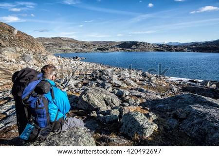 Hiker takes a break in Lapland-Sweden - stock photo