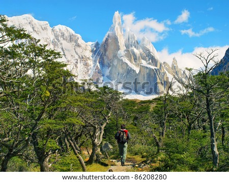 Hiker trekking in scenic landscape with Cerro Torre in the background in Los Glaciares National Park, Patagonia, Argentina, South America - stock photo