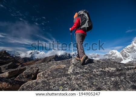 Hiker walks on train in Himalayas - stock photo