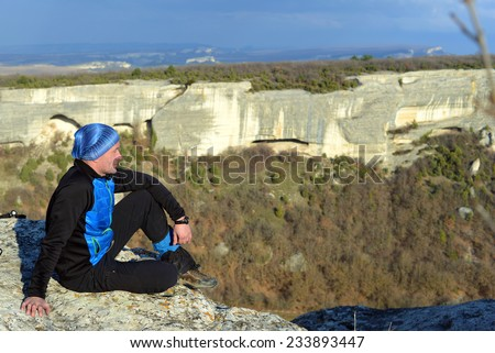 Hiker watch to the valley - stock photo