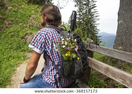 Hiker with backpack and sticks in the Bavarian mountains, Germany - stock photo