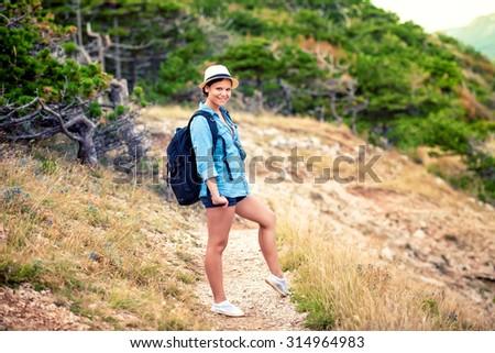 Hiker with backpack on mountains, trekking and enjoying natural, fresh air - stock photo