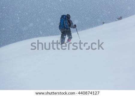Hiker with snowshoes in winter - stock photo