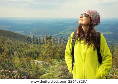 Hiker woman enjoying sun. Happy outdoor portrait.  - stock photo