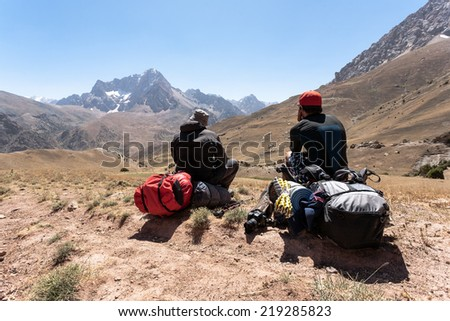 Hikers in Fann mountains, central asia, Tajikistan. - stock photo