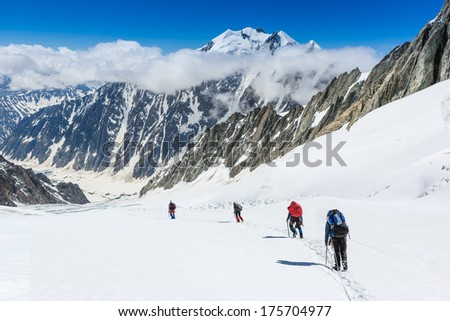 hikers in the mountains  - stock photo