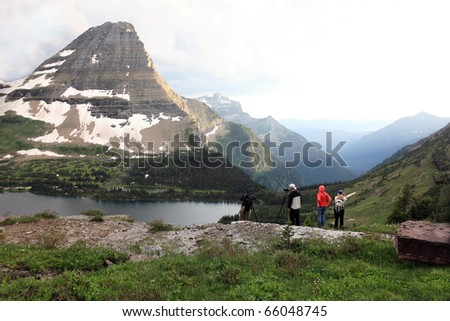 Hikers on the Hidden Lake Trail in Glacier National Park, Montana. - stock photo