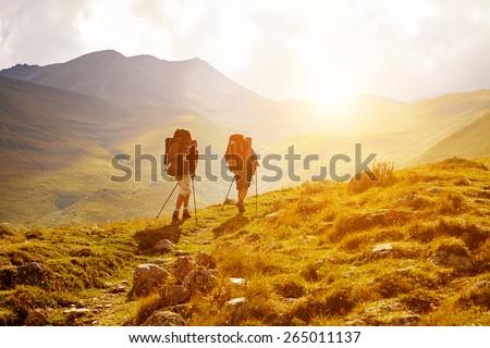hikers on the trail in the Caucasian mountains. Trek to Kazbek mount - stock photo