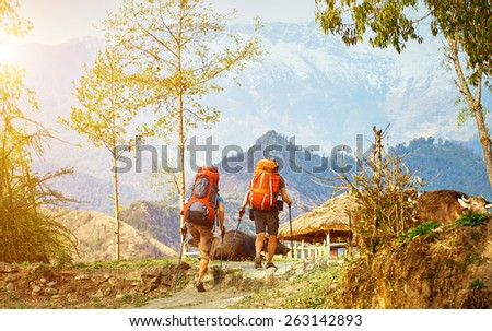 hikers on the trail in the Himalayan mountains. Trek around Annapurna mount - stock photo