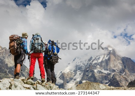 Hikers team explore the mountains - stock photo