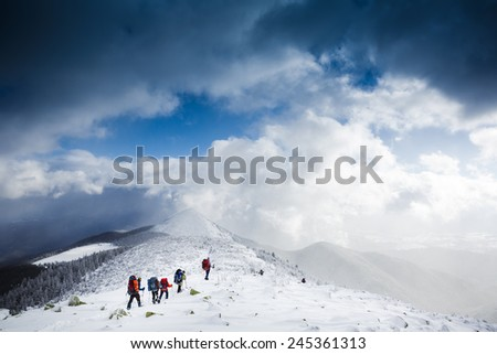 hikers team in winter mountains. Sport lifestyle travel concept  - stock photo