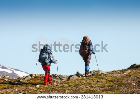 Hikers team trekking in Crimea mountains - stock photo