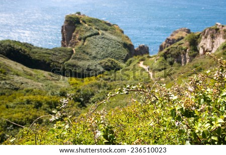 hikers walking along coastal paths on Sark, Channel Islands - stock photo
