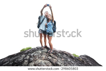 Hikers with backpack standing on the rock and taking selfie isolated on white background - stock photo