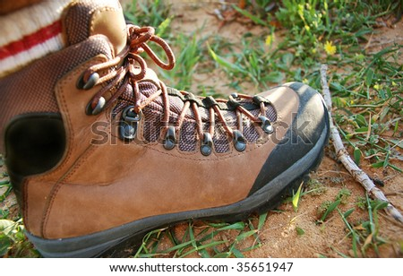 hiking boot in natural environment - stock photo