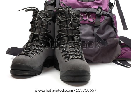 Hiking boots and bag, isolated on white - stock photo