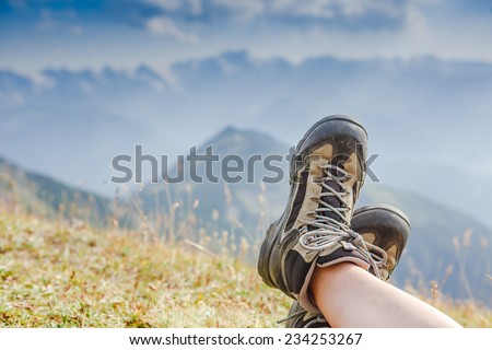 Hiking boots in the mountains. Resting time. Freedom concept - stock photo