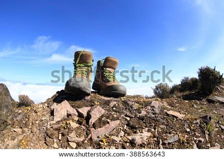 hiking boots on beautiful mountain peak - stock photo