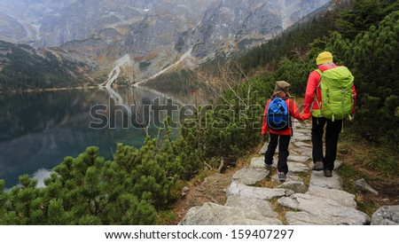Hiking - family on mountain trek - stock photo