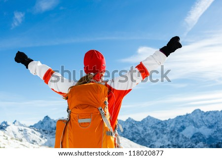 Hiking happy woman and success in mountains. Fitness and healthy lifestyle outdoors in winter nature. Motivation and Inspiration Concept, Raised Arms over Tatra Mountains landscape in Poland. - stock photo