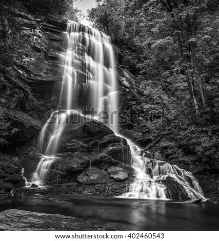 Hiking in Western North Carolina has its rewards. Upper Catawba Falls is such a place. The hike is hard as using a rope to pull yourself up is part of getting there. But the beauty makes it worth it. - stock photo