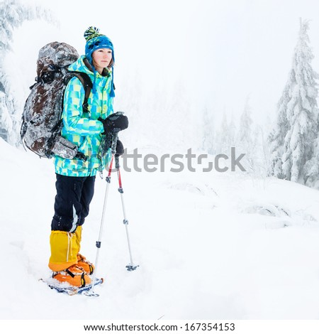 Hiking in winter mountains  - stock photo