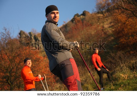 Hiking men -outdoor in forest - stock photo