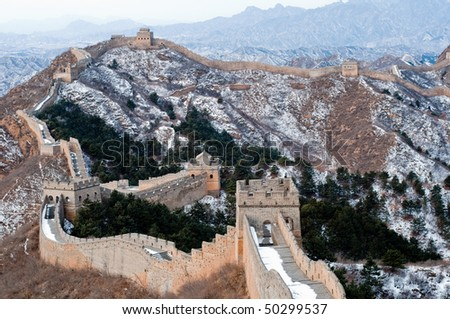 hiking on the great wall of china in winter - stock photo