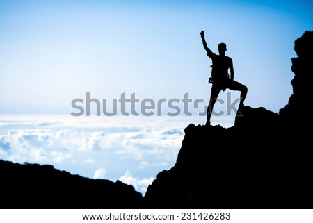 Hiking or climbing young man silhouette and success in mountains. Fitness and healthy lifestyle outdoors in summer nature - stock photo