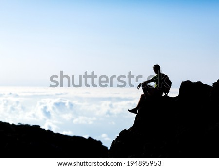 Hiking or running silhouette backpacker, man and success in mountains on mountain peak. Fitness and healthy lifestyle outdoors in summer nature on La Palma, Canary Islands - stock photo