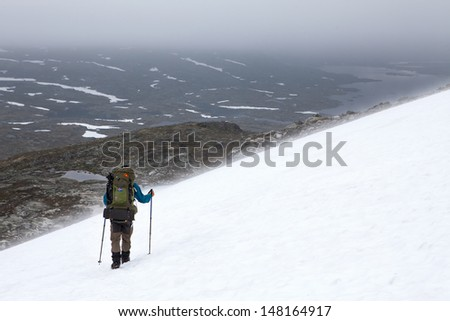 Hiking over Snow fields - stock photo