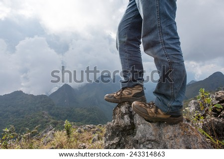 Hiking shoes on the summit from hike walk in Doi Luang Chiang Dao , Chiang Mai , Thailand - stock photo