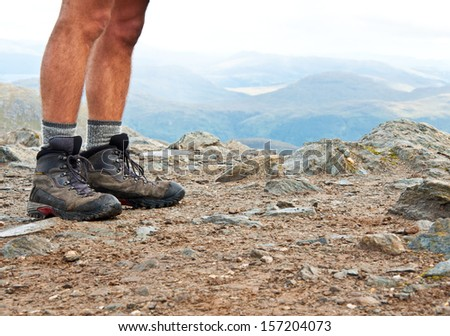 Hiking shoes on the summit from hike walk in Scotland  - stock photo