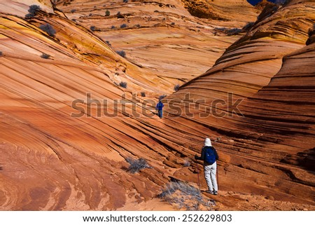 Hiking through the buttes in the Vermilion Cliffs National Monument - stock photo