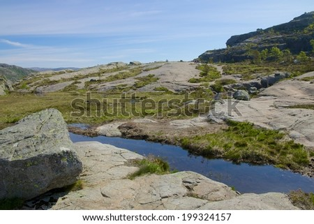 Hiking trail and alpine landscape of the Preikestolen and Lysefjord area in Rogaland, Norway - stock photo