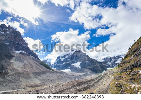 hiking trail in a glacier valley and peaks in banff national park in the rocky mountains of alberta canada - stock photo